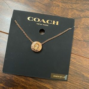 Rose gold Coach necklace